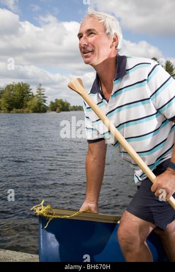 man with canoe - Stock Image