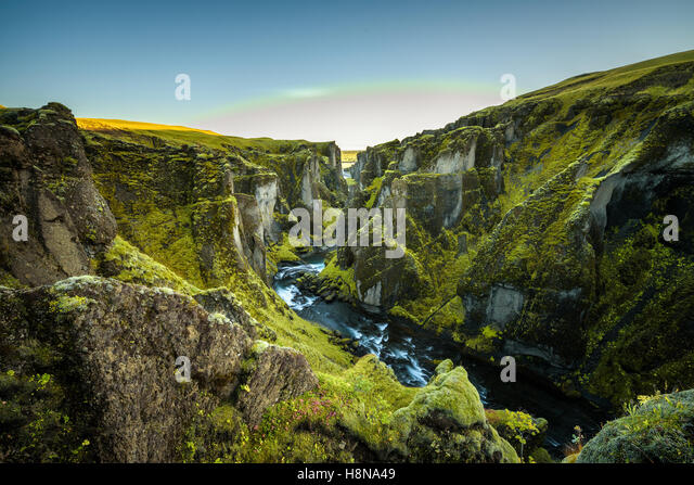 Deep Fjadrargljufur canyon and river flowing along the bottom of the canyon in south east Iceland - Stock Image