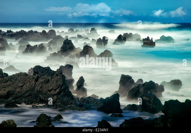 Volcanic seastacks with waves, Maui, Hawaii - Stock Image