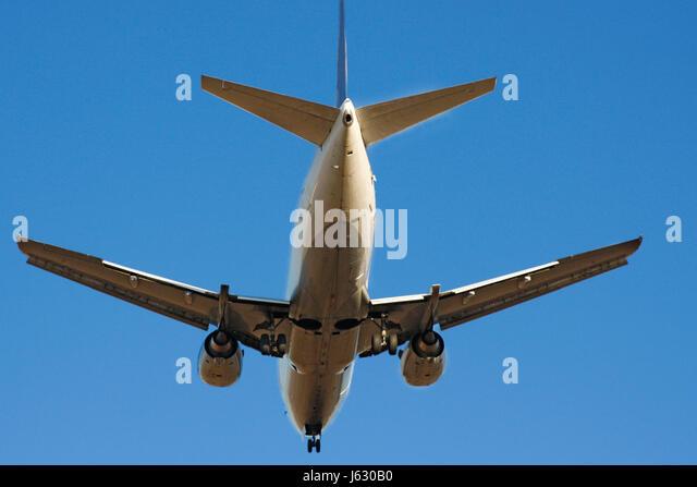 arrival landing trunk fuselage firmament sky aircraft aeroplane plane airplane - Stock Image