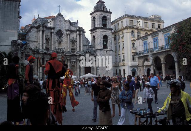 Carneval dressed stiltwalker dancing on Plaza de Catedral January sunday afternoon Old Havana Cuba - Stock Image