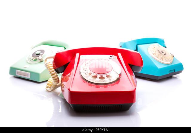 Set of vintage telephones isolated over white background - Stock Image