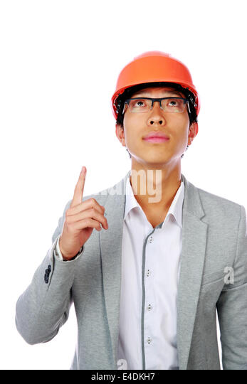 Asian engineer man point up isolated on white background - Stock Image