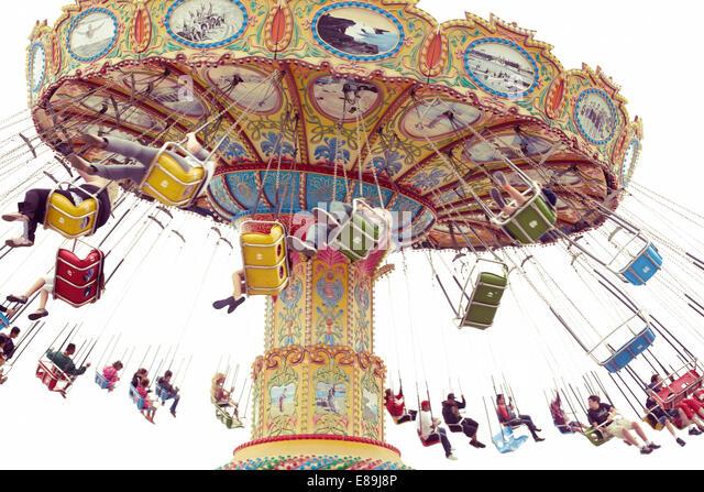 Spinning swings at fair - Stock-Bilder