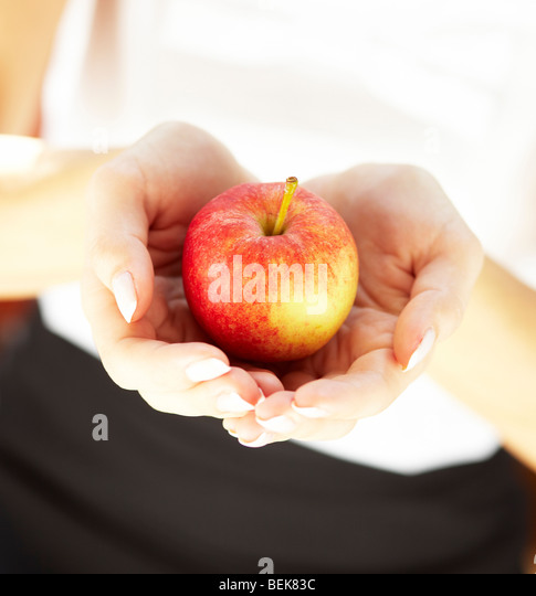 Close up of person holding apple - Stock-Bilder