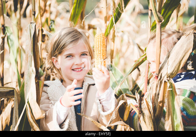 Two girls playing in maize field - Stock Image