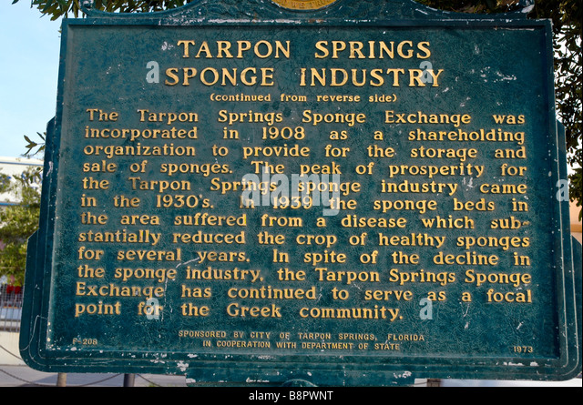 Tarpon Springs Fl Sponge Industry sign historic marker on Dodecanese Avenue Florida Greek community - Stock Image