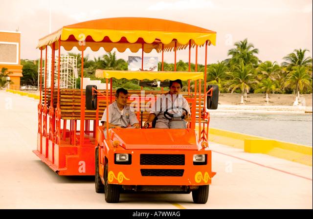 Puerto Costa Maya cruise pier passenger tourist trolley - Stock Image