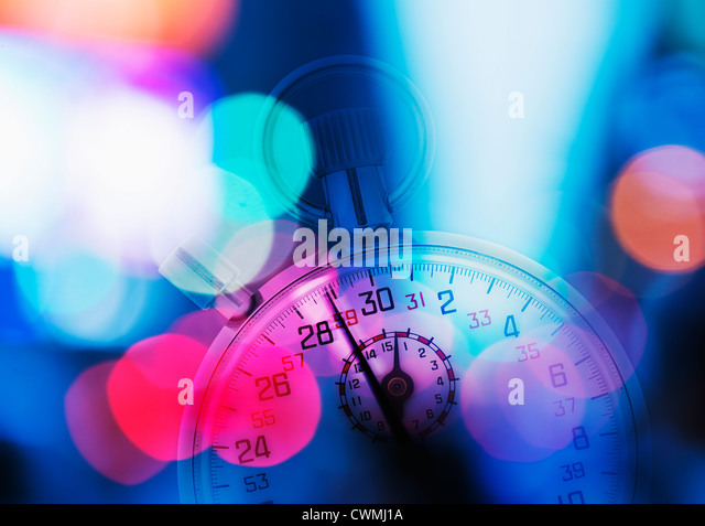 USA, New York, New York City, Stopwatch and colorful lights - Stock Image