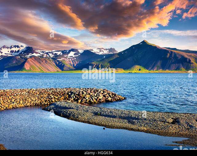 Sunny summer morning in the Icelandic fjords. Colorful sunrise near the small town Grundarfjordur, Snaefellsnes - Stock Image