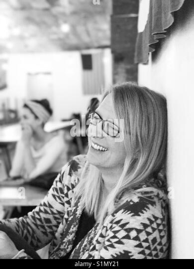 Best girlfriend in a coffee shop. Black n white - Stock Image