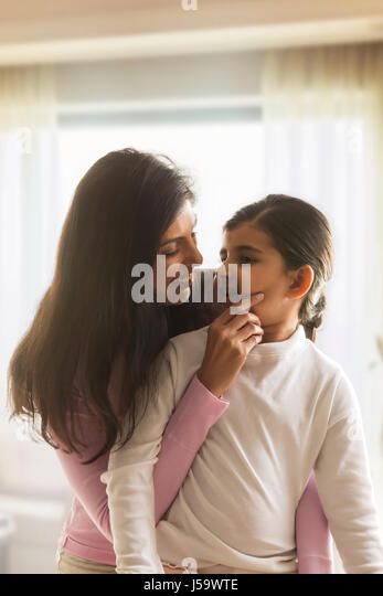 Young mother and daughter looking at each other - Stock-Bilder