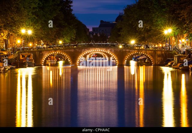 Bridges at dusk Amsterdam, Netherlands, Holland - Stock Image