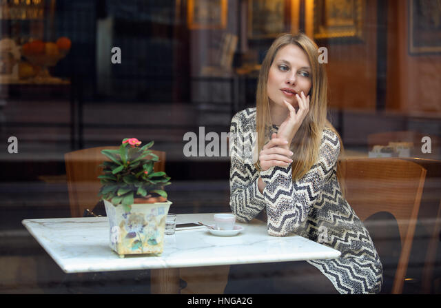 Elegant young woman in a classy cafe. Urban shot - Stock-Bilder