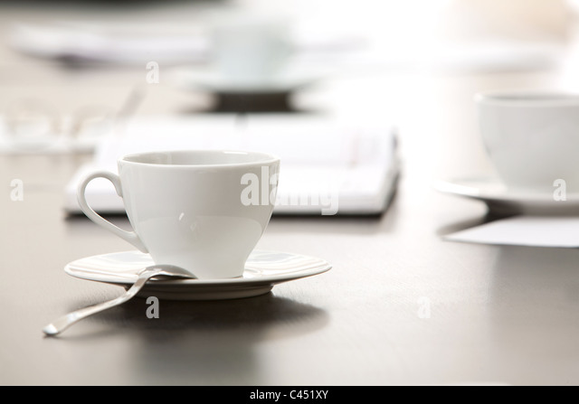 Morning workplace: cup of coffee and business objects on the table - Stock-Bilder