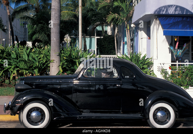 Miami Florida FL South Beach Classic Art Deco Architecture Ocean Drive classic black car with mannekin inside as - Stock Image
