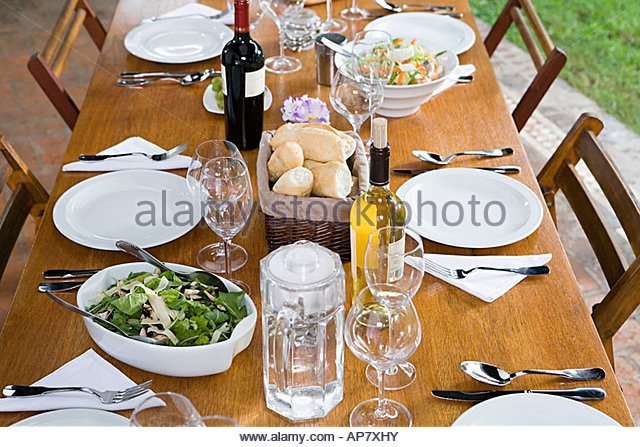 Food and drink on a table - Stock Image