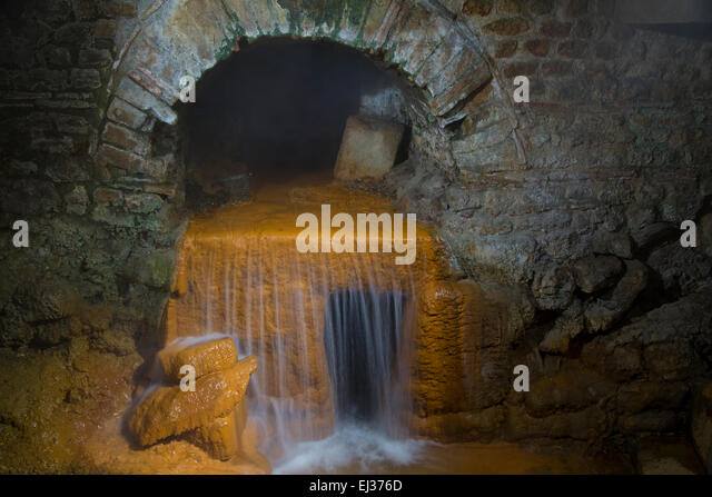 Underground hot springs at the Roman Baths in Bath, Somerset, England, UK - Stock Image