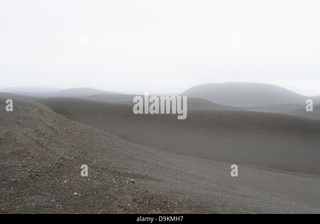 Grey misty hills in empty landscape - Stock Image