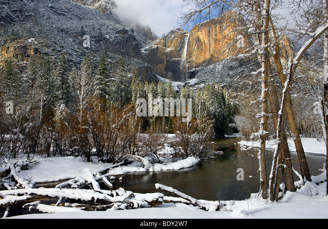 The Merced River winds it way past Yosemite Falls after a clearing winter storm. Yosemite National Park, California, - Stock-Bilder