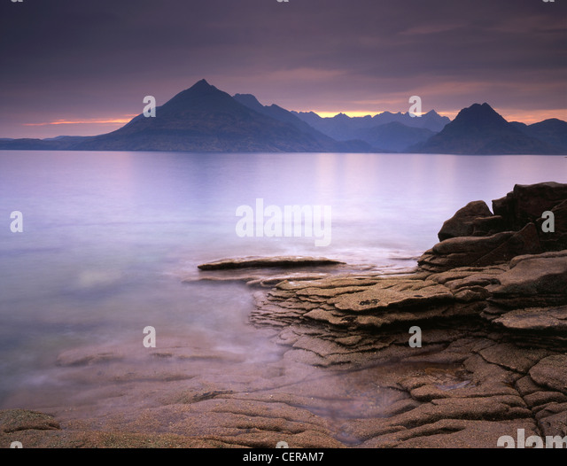 The view across Loch Scavaig from Elgol. It shows the serrated ridge of the Cuillin range and is one of the finest - Stock Image