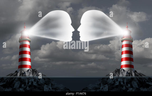 Partner communication business concept as two lighthouse structures at sea shaped as human heads communicating together - Stock Image