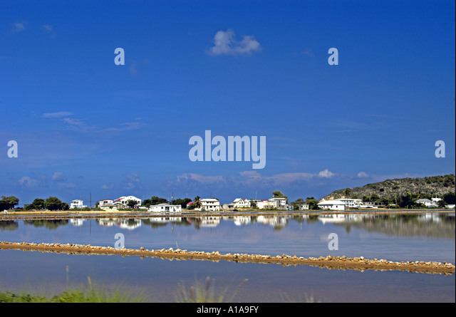 Anguilla salt pans full of water Sandy Ground  in the distance behind - Stock Image