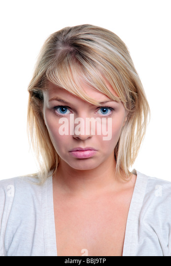 Attractive blond woman with a sad expression on her face isolated on a white background - Stock Image