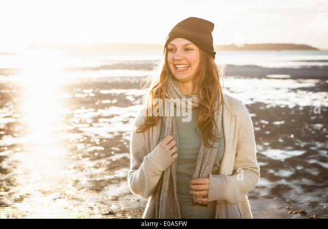 Happy young woman on the beach - Stock Image