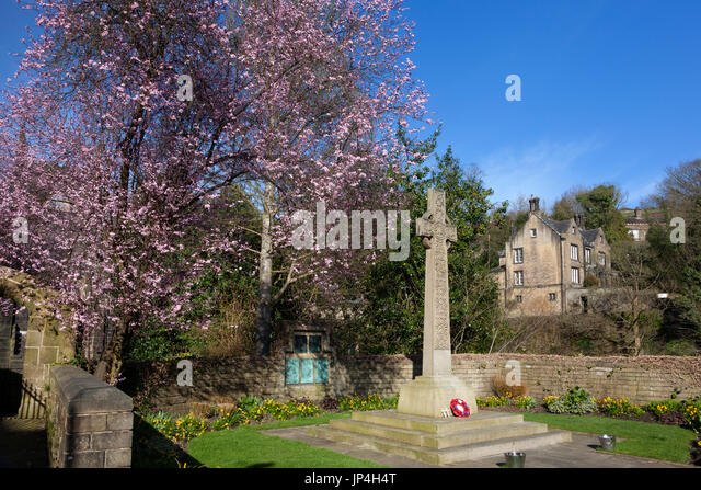 War memorial with Spring blossom, Luddenden, West Yorkshire - Stock Image