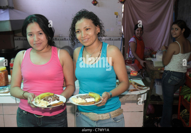 Nicaragua Managua neighborhood cafeteria restaurant family business dining typical food plate rice and beans banana - Stock Image