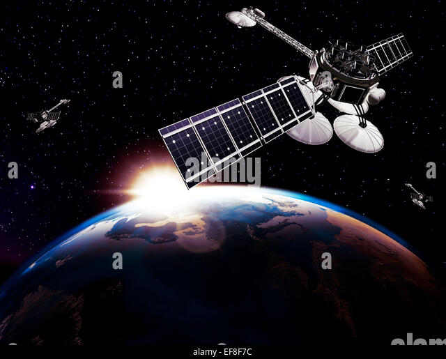 Communication satellites, Comsat, above Earth globe lit by the rising Sun on black starry sky background. Space - Stock Image