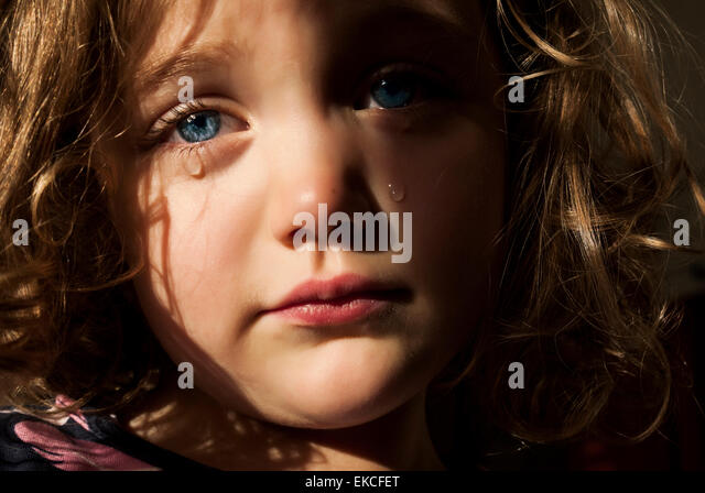 Young girl crying - Stock Image