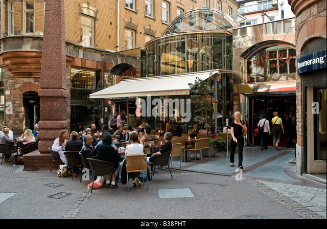 Outdoor restaurant Tures on Grev Turegatan in central Stockholm Sweden - Stock Image