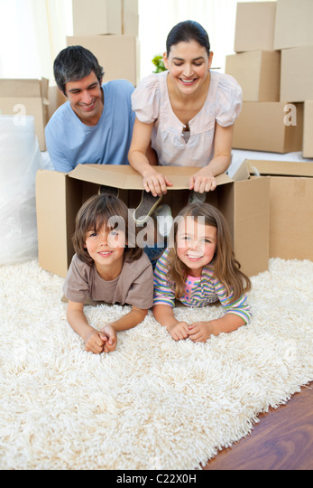 Jolly family playing with boxes - Stock Image