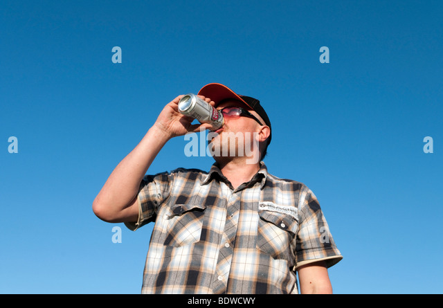 Man drinking lager from a can, England, UK - Stock-Bilder