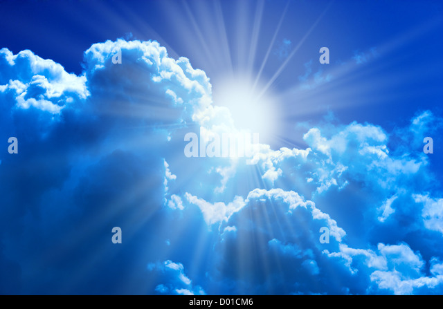 Sun and clouds beautiful natural religion background - Stock Image