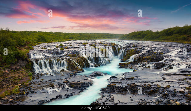 Summer sunset with unique waterfall - Bruarfoss. Colorful evening scene in South Iceland, Europe. - Stock Image