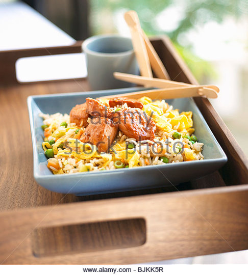 Sweet and sour salmon on rice - Stock Image