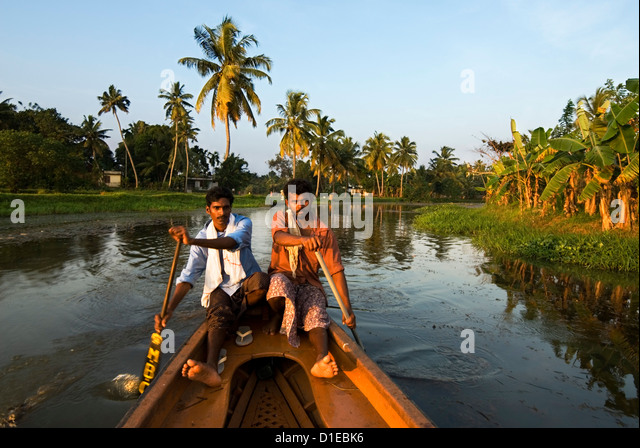 Canoeing along the Backwaters, near Alappuzha (Alleppey), Kerala, India, Asia - Stock Image