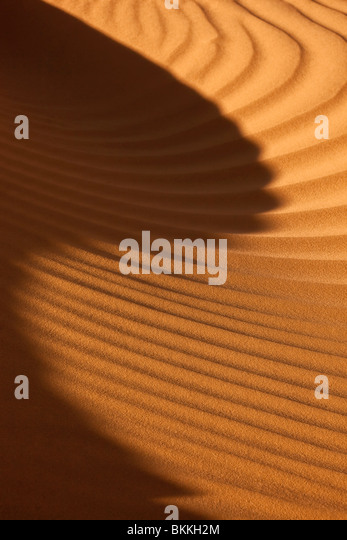 close-up of sand pattern with shadow in the Sahara of Morocco - Stock Image