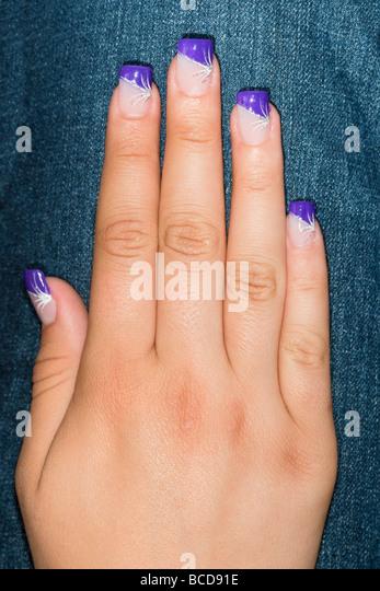 Purple acrylic nails - Stock Image