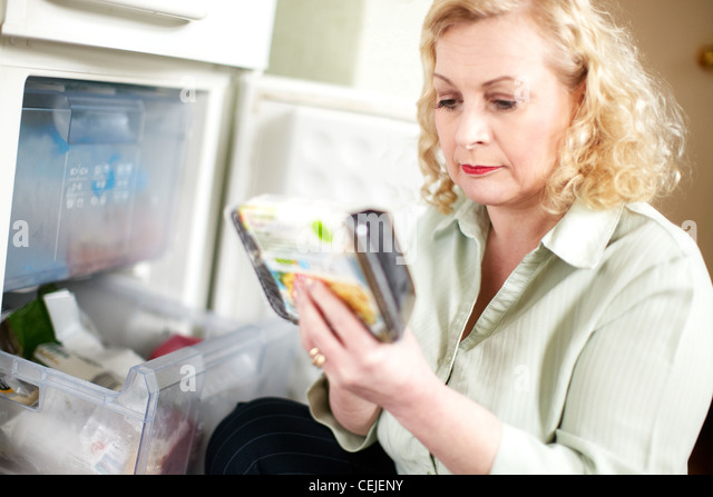 Woman with freezer meal - Stock Image