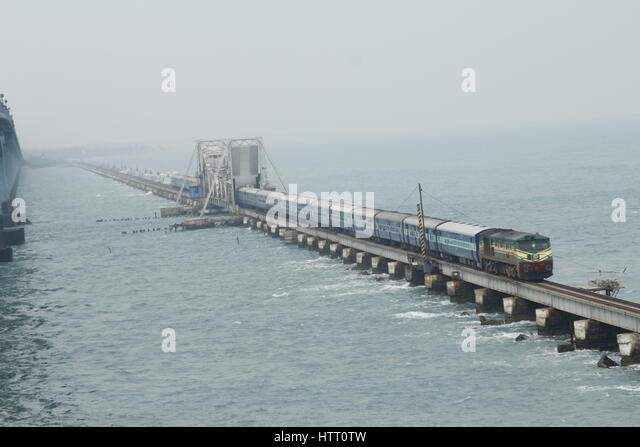 A train on the Pamban Bridge that connects Rameswaram to the Indian Mainland - Stock Image