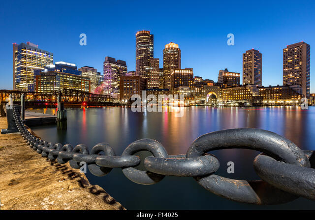 Boston skyline at dusk as viewed from Fan Pier Park. - Stock Image