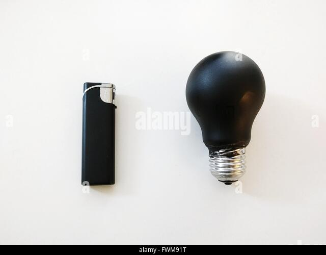 Directly Above View Of Black Light Bulb Cigarette Lighter - Stock Image