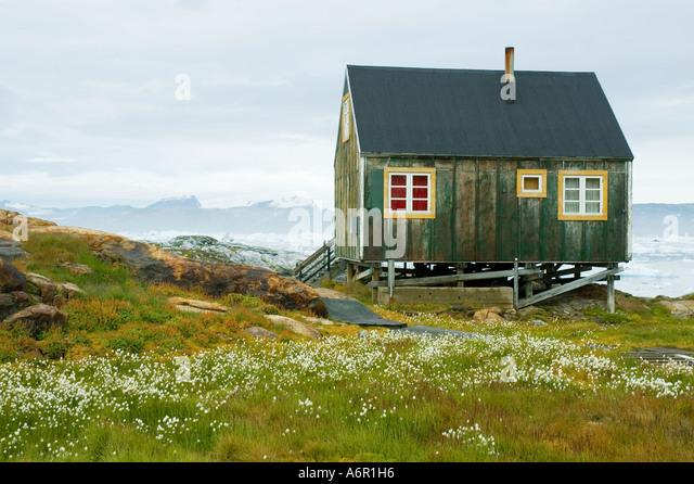 Inuit hut at the village of Tiniteqilâq, Sermilik Fjord, East Greenland - Stock Image