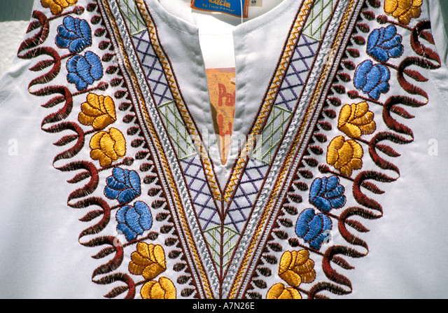 Greece embroidery on woman s blouse in Mykonos - Stock Image