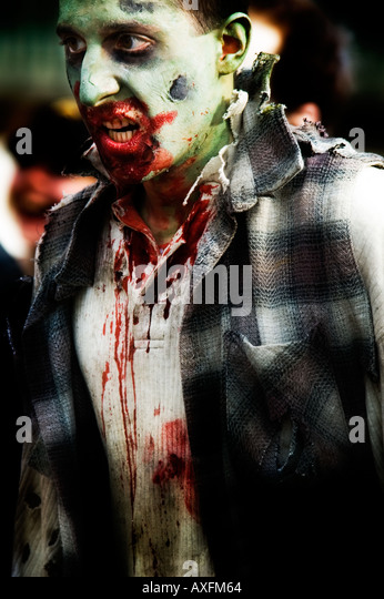 A zombie terrorizes the living in the first annual Calgary Zombie Walk - Stock Image
