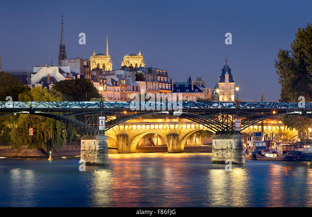 Pont des Arts, Pont Neuf, Notre Dame de Paris Cathedral towers and Seine River. Illuminated evening view. Ile de - Stock Image